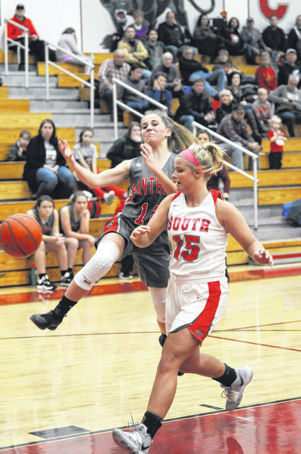 Twin Valley South's Mackenzie Neal blocks a shot by North's Maddy Flory in a basketball game on Thursday, Dec. 19, at South. South pulled away in the second half for its first win of the season, 33-16.