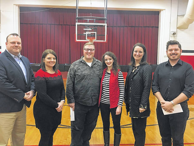 Preble Shawnee K-6 General Music Teacher Cody McPherson was recognized by the district as OMEA 2020 Outstanding Young Music Educator of the Year on Thursday, Dec. 19. Pictured above: Superintendent Matt Bishop (left), Camden Primary Principal Heather Campbell, Cody McPherson, Sarah McPherson, OMEA Director of Media and Publications Amy Annico, and Band Director David Lewis (right).