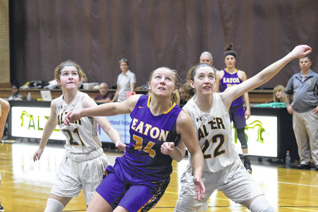 Eaton freshman Olivia Baumann battles for a rebound during the Eagles game at Alter on Saturday, Dec. 28. She finished the game with a team-high 12 rebounds to help her team to 36-33 win. Eaton improve to 8-1 with the win.