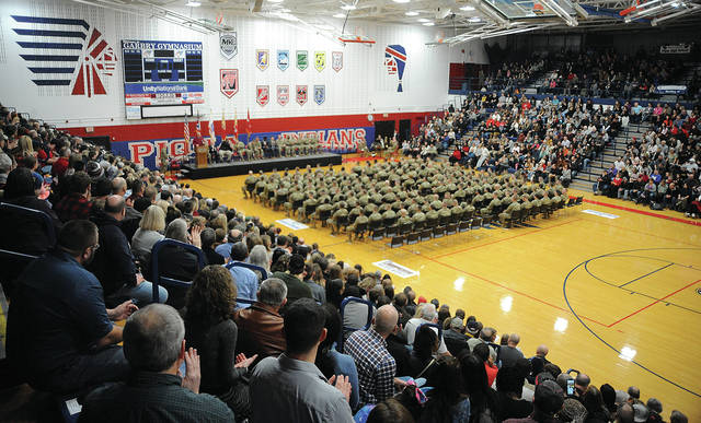 A capacity crowd of dignitaries and guests filled Piqua High School's Garbry Gymnasium on Saturday for the Call to Duty ceremony for the 1487th Transportation Company, Ohio National Guard, as they prepare for an overseas deployment.
