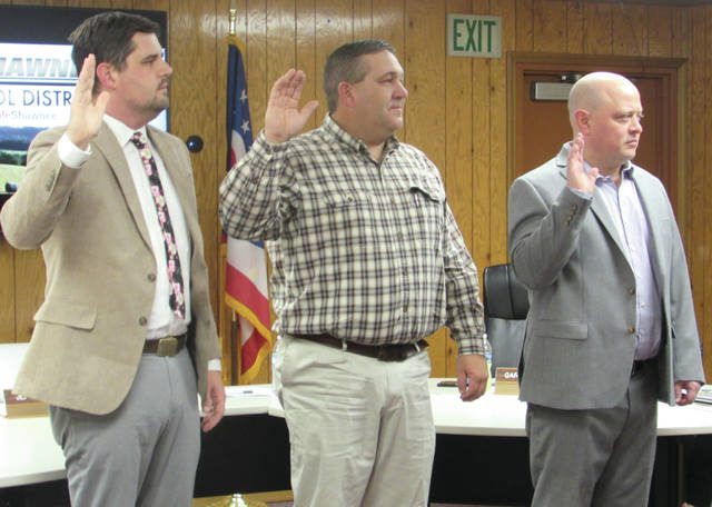 Newly re-elected Preble Shawnee school board members Gary Rader, Nick Duskey, and Jeff Wood were sworn in at the top of Monday's meeting.