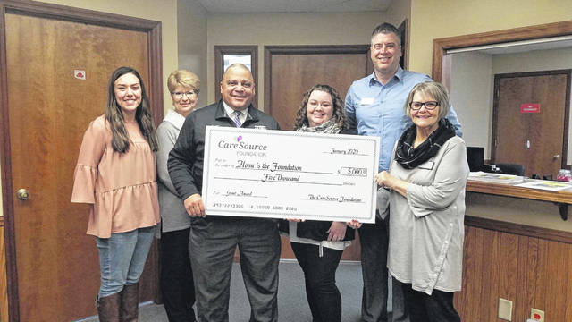 Preble County Home is the Foundation (HIT Foundation) received a grant in the amount of $5,000 from the CareSource Foundation on Monday, Feb. 10. Pictured left to right: Jennifer Stan (Housing Focused Case Manager), Ginger Roth (Senior Home Repair Program Manager), Joseph Smith (CareSource), Lindsay Watson (Program and Grants Management Coordinator), Clayton Genth (Executive Director), and Kathy Smallwood (Board Member).