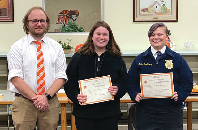 High School Students of the Month Dakota Gibbsand Kindra Holloway, with principal Mike Eyler.