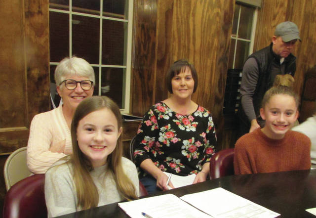 Preble Shawnee elementary students Shelby Lane and Addyson House, with council members Judy Michael and Toni Keesler.