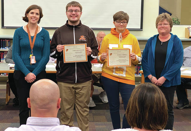 High School students Garland Weaver and Kiara Carrell, who won Superior ratings at the Ohio Music Education Association's District 13 High School Solo and Ensemble Feb. 8. Also pictured: Band Director Alicia Norrod and Steel Band and Choir Director Judy Jordan.