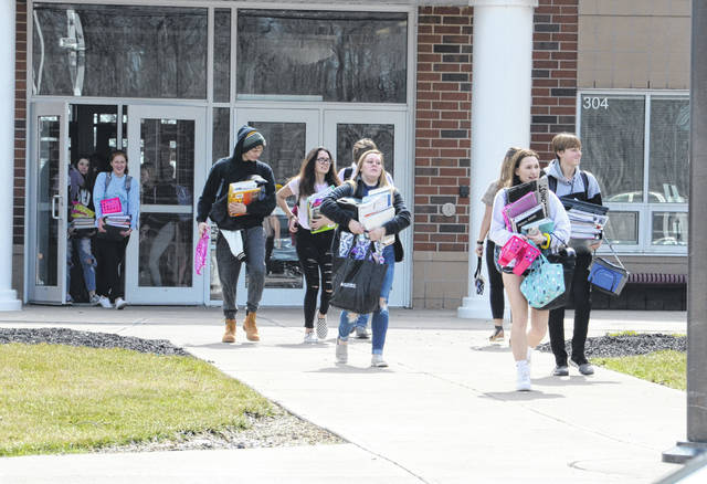 All Preble County school districts were forced to close for the next three weeks due to the state-wide order. Eaton High School students are pictured leaving school on their last day, Friday, March 13.