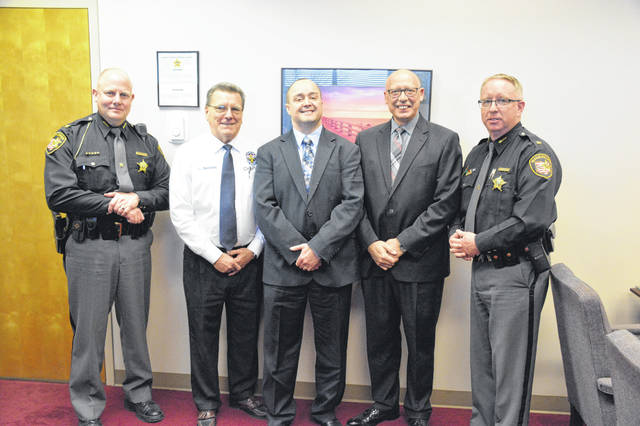 Pictured, left to right, Chief Deputy Mike Spitler, Pastor Larry Bennett Sr., Chaplain of the Louisville Police Department; Rev. Don Thomas, Pastor Ken Harbaum and Sheriff Mike Simpson.