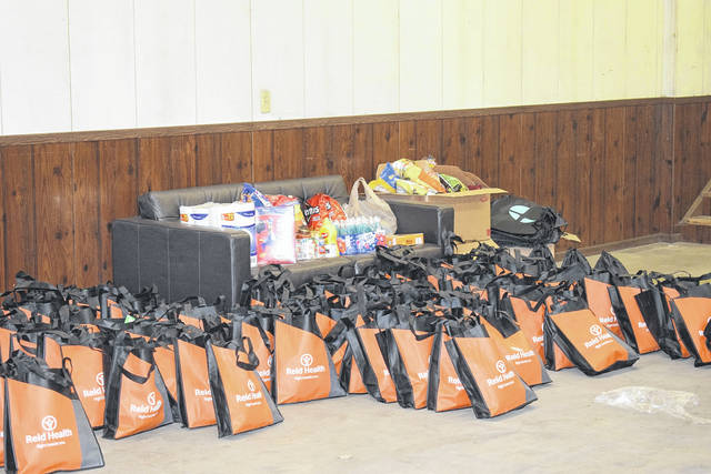"Tri-County North Local School District partnered with Community of Faith and Success Liaison April Gross to host the ""For the Kids"" food drive for students of all ages. Families are able to pick up bags of food containing seven days worth of breakfasts and lunches every Thursday from 3-5 p.m. at 111 Water Street, Lewisburg."