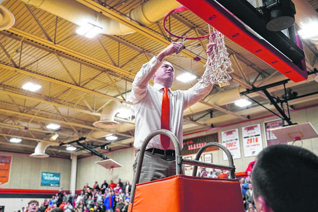 National Trail boys' basketball coach Mike Harrison was selected at the Cross County Conference Coach of the Year after leading his team to its first league title since the 2002-2003 season.