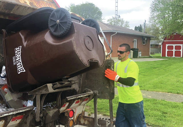 Eddie Lang works an early-morning garbage collection route in Eaton five days a week, including during the current Covid-19 pandemic.
