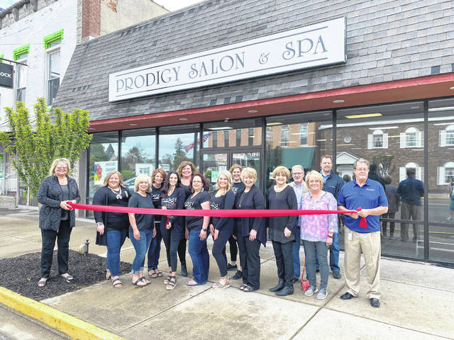 Preble County businesses have begun to reopen according to the schedule provided in the state's Responsible RestartOhio plan. On Friday, May 15, sectors permitted to open included personal services like salons, tatoos shops and more, and outside dining for restaurants. New Preble County Chamber of Commerce member Prodigy Salon and Spa in Eaton celebrated with a quick, symbolic ribbon cutting for all those newly opened with county and city officials.
