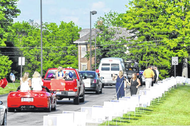 Twin Valley South graduation festivities began with a parade procession made up of students and parents in their vehicles which started at the high school and wound through the streets of West Alexandria before returning to the school. Families were encouraged to decorate their vehicles, and many responded with messages to the students, colorful ribbons and pictures of graduates. The parade was accompanied by representatives from the West Alexandria Police Department and Fire Department.