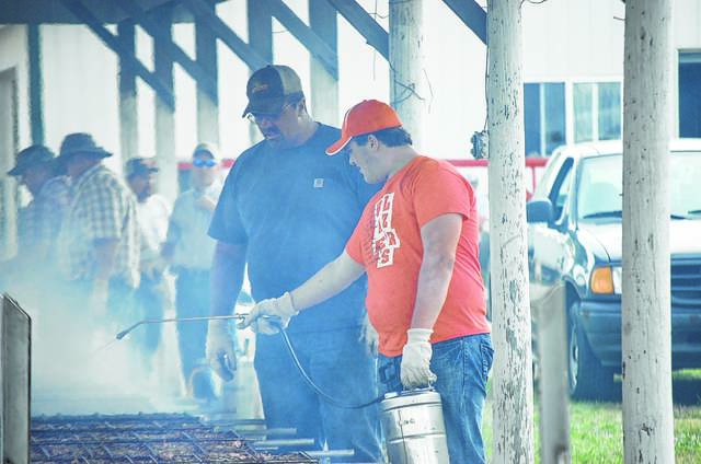 Men watch over the cooking pork Sept. 20 at the Preble County Pork Festival.