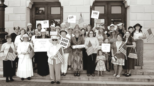 Preble County women posed for pictures in front of the courthouse Thursday to commemorate the 100th anniversary of the 19th amendment to the U.S. Constitution, which granted women in the United States the right to vote.