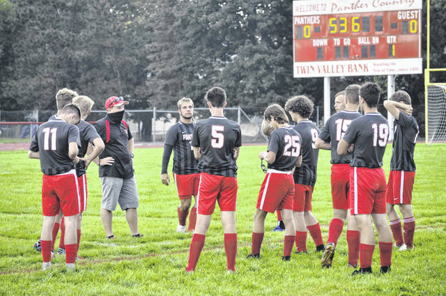 Twin Valley South's boys prepare to take the field before their match against Carlisle. South won 4-1.