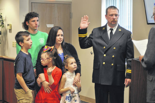 Captain Bekemeier and family during his swearing in