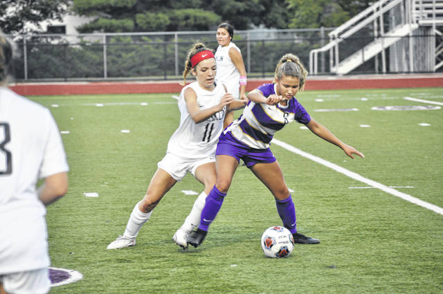 Eaton junior Amyah Thacker fights for the ball during Eaton's game against Franklin on Thursday, Sept. 10. Eaton lost 2-0.
