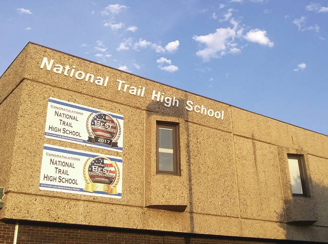 National Trail High School has chosen to suspend in-person classes until at least Monday, Oct. 5 due to four students testing positive for the coronavirus.