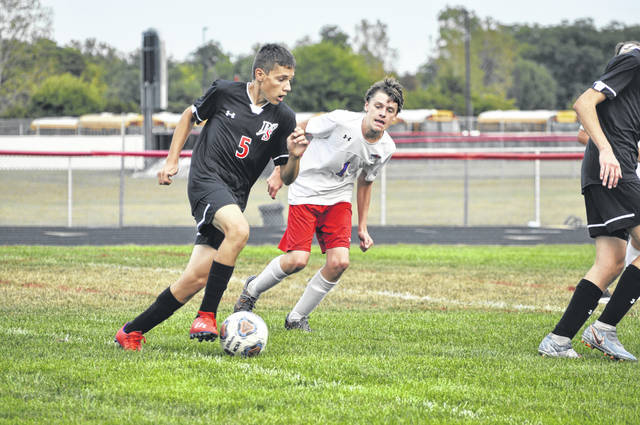 Preble Shawnee freshman Case Roell moves past a Union County defender during Shawnee's game against Union County on Wednesday, Sept. 16. Shawnee won 5-4.