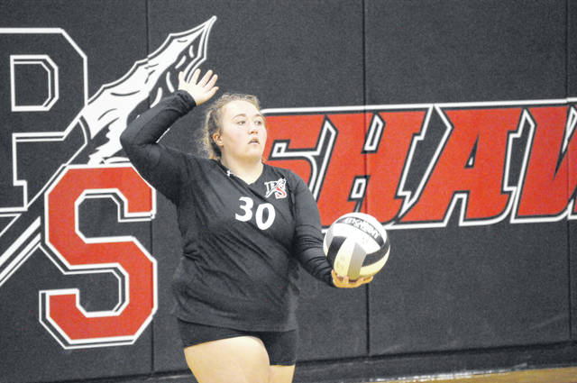 Senior Madison Hibbard prepares to serve during Preble Shawnee's match against Milton-Union on Thursday, Sept. 3. Preble Shawnee won 3-2.