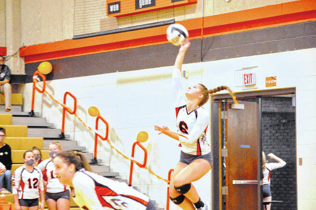 National Trail freshman Addison Sparks delivers a serve during Trail's match against Mississinawa Valley on Tuesday, Sept. 15. Trail won 3-2.