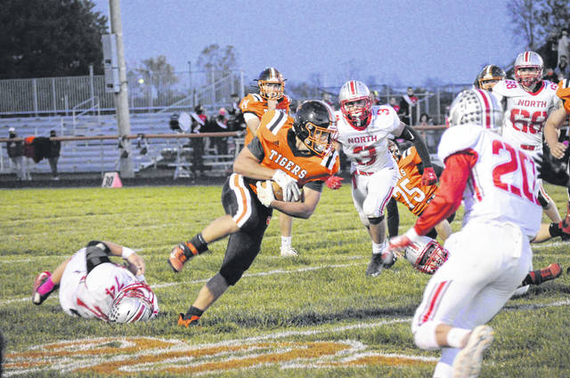 An Ansonia runner breaks tackles by Tri-County North during their playoff game on Friday, Oct. 16. North lost 17-6.