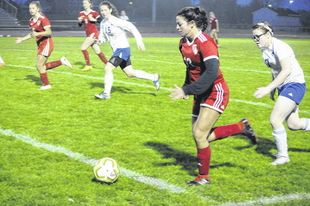 Twin Valley South junior Makiah Newport races down the sideline during South's Sectional/District tournament game against Middletown Christian on Tuesday, Oct. 20. South won 5-1.