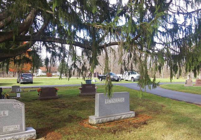In addition to its massive size, the tree shelters the graves of numerous local veterans.