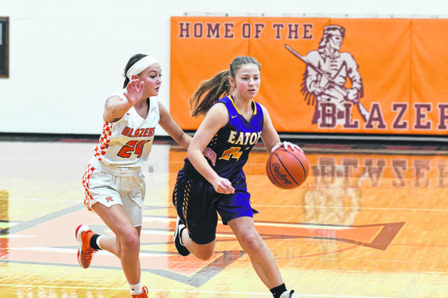 Eaton then-sophomore Allison Mowen is guarded by National Trail then-senior Davlyn Werner during a girls high school basketball game on Saturday, Dec. 7, 2019.