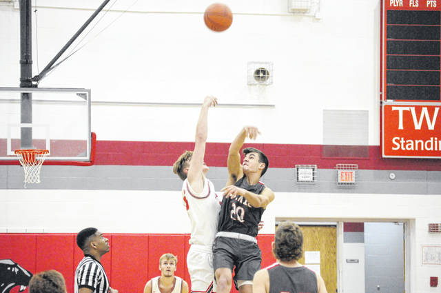 Twin Valley South senior Levi Gearhart goes up for the opening tip during South's game against Dixie on Saturday, Nov. 28. South lost 48-25.