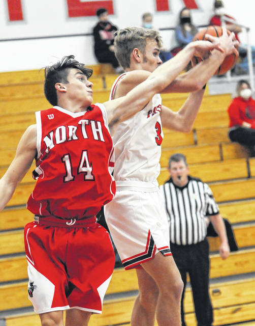 Twin Valley South's Brayden Marker battles with Tri-County North's Ty Cross for a rebound in a battle of the Panthers on Tuesday, Dec. 15. Marker scored a game-high 17 points to lead South to a 65-50 win.