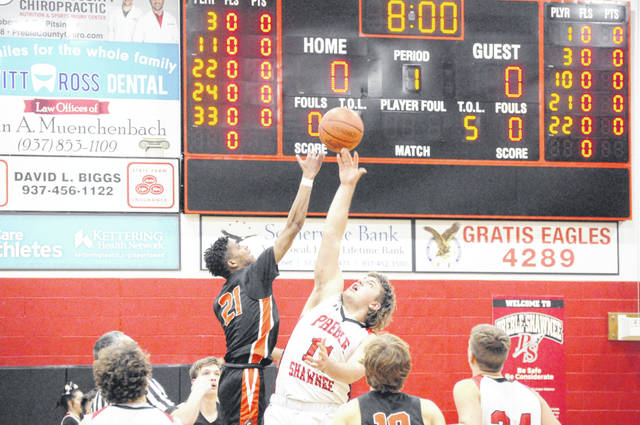 Preble Shawnee junior Xavier Adams goes up for the tip-off during Shawnee's game against Waynesville on Friday, Jan. 15. Shawnee won 81-64.