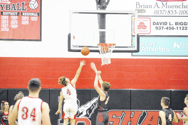Tri-County North junior Braeden Rike goes up for a shot during North's game against Twin Valley South in the Preble Shawnee Holiday Tournament on Wednesday, Dec. 30. North won 58-39.