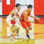Trail withstands North rally to hold on for 74-63 win