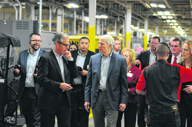 U.S. Senator Rob Portman talks with Henny Penny Chairman & CEO Rob Connelly on Friday, Dec. 7, 2018, during a tour of Henny Penny. He later participated in a town hall with Henny Penny employees.