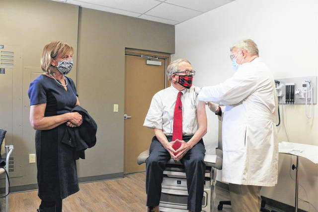 Ohio Gov. Mike DeWine and First Lady Fran DeWine received their COVID-19 vaccinations from Dr. Kevin Sharrett at Kettering Health Network's Jamestown office in Greene County on Tuesday, Feb. 2.