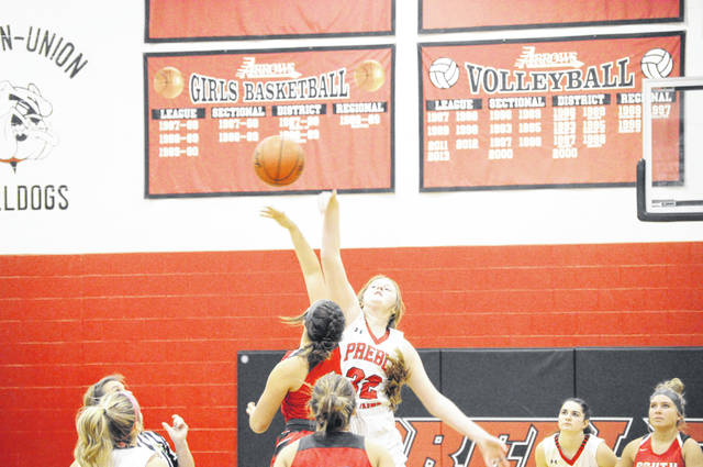 Preble Shawnee freshman Kahlen Kulms wins the tip against Twin Valley South on Saturday, Jan. 30. Shawnee won 63-40.