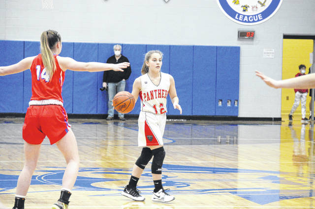 Tri-County North senior Maddy Flory takes the ball down the court during their game against Tri-Village on Thursday, Feb. 18. North lost 76-16.