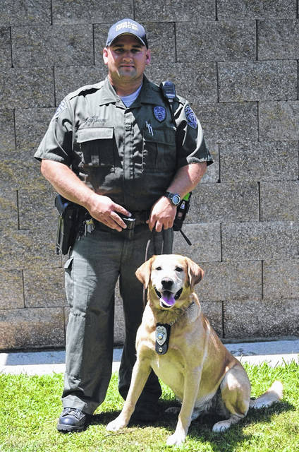Natural Resource Officer Jason Lagore and his K-9, Sarge.