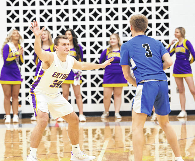 Eaton junior Clayton Kiracofe defends Brookville's AJ Eller during the first half of the SWBL Southwestern Division game on Tuesday, Feb. 9. Eaton scored 29 points in the final quarter, but fell 67-62.