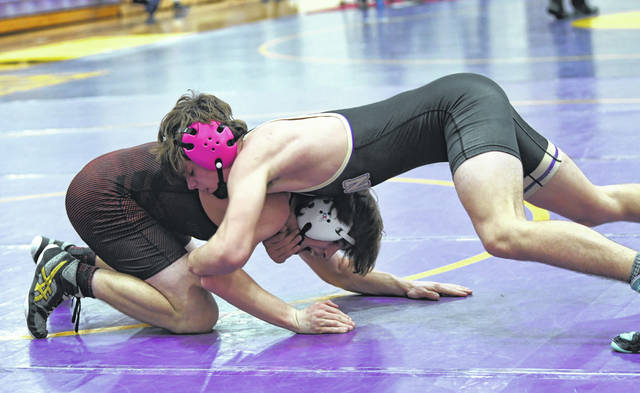 Eaton's Danny Caldwell (right) battles with Preble Shawnee's Sayge Stephenson during the second round of the SWBL tournament on Friday, Feb. 5.