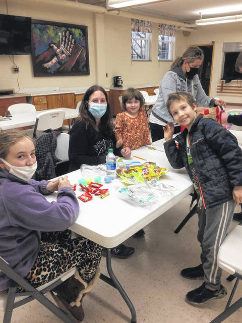 The Lohrey Family helps fill easter eggs on March 15.