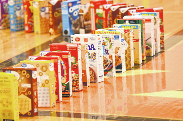 Nearly 250 cereal boxes decorated the gymnasium floor, modeled after an activity seen accomplished by another school in a YouTube video, according to Stevenson, who said this activity was selected because the students really enjoy playing with dominoes.