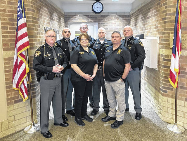"""The Preble County Sheriff's Office recently recognized """"Employees of the Year"""" from each division for 2020. Employees are recommended by supervisors in their respective divisions based on several criteria, including work ethic, professionalism, job knowledge, commitment, and teamwork. Pictured, left to right, Sheriff Mike Simpson, Dep. Nikolas Soder, Dep. James Randy Tunnel, Dispatcher Terri Shepherd, Dep. II Ty Chellis, CCW Technician Randy Creech, and Capt. Shane Hatfield."""