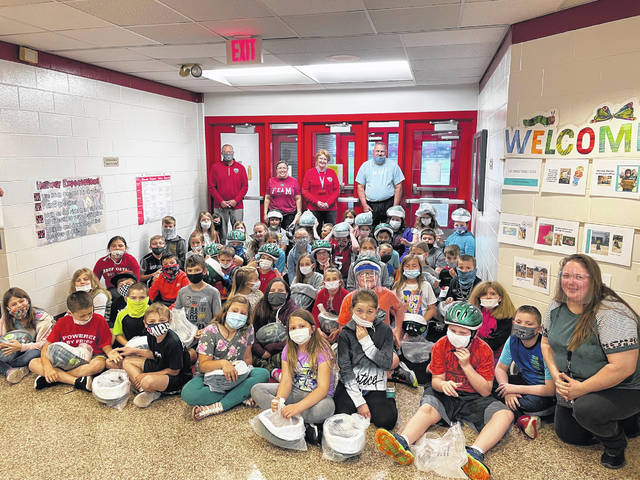 Preble Trails delivered bike helmets to 425 third graders on Tuesday, May 4.