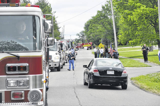 The Village of Gratis held a parade on Sunday, May 30 to commemorate Memorial Day. Participants included various municipal vehicles, community members and military volunteers.