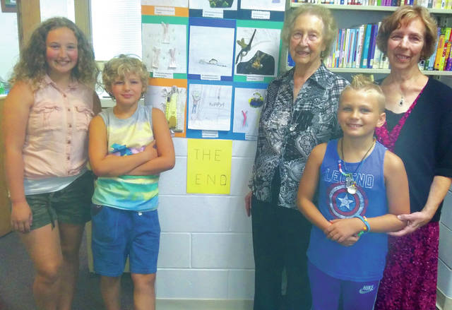 Penny Johnston and JoAnn Harris (pictured with a trio of younger library patrons) will retire on Saturday after a combined total of 91 years of service to Marion Lawrence Memorial Library.