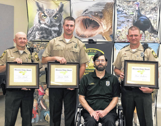 Wildlife Officers Eric Lamb, Jason Keller and Matt Roberts were honored during a ceremony on Monday, June 28.