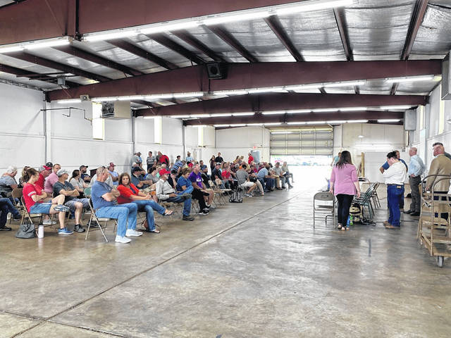 Nearly 100 people turned out to the Preble County Fairgrounds' Toney Building on Monday, July 12 for a public meeting with the Preble County Board of Commissioners and Norfolk Southern regarding potential railroad crossing closures in the county.