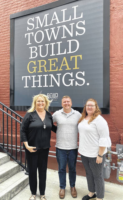 Preble County Development Partnership Economic Development Director Brenda Latanza (left) and Preble County Chamber of Commerce Executive Director Leslie Collins (right) are pictured outside the BUILD Cowork + Space in Bellefontaine with Small Nation founder Jason Duff. Latanza and Collins attended the first-ever Small Nation Hometown Opportunities platform user conference on Friday, June 25.